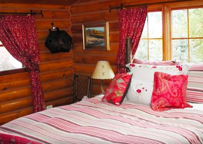 Queen Bedroom in the Homestead Cabin (1 of 3 bedrooms)